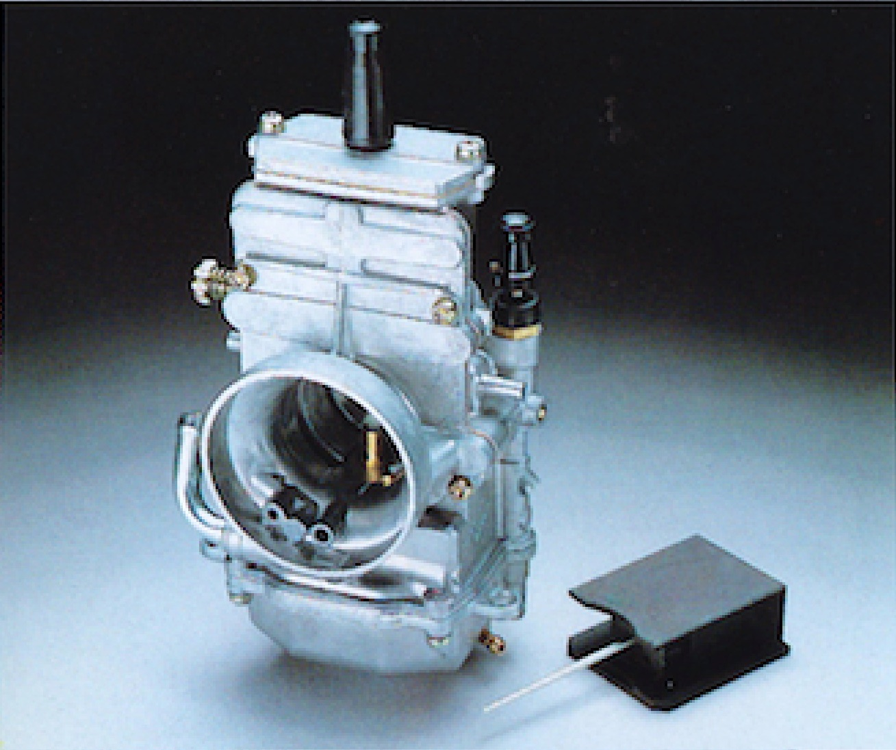 The RM's 34mm flat-slide Mikuni carburetor looked cool, but did very little  to aid the Suzuki's meager output.